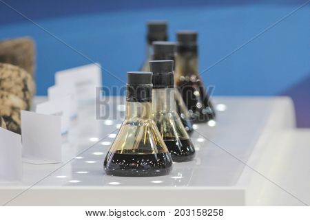 Crude oil in vial on exhibition, telephoto view