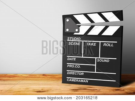 Movie clapper on a wooden background, cinema concept