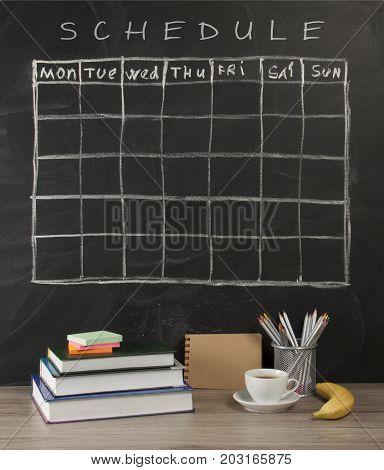 Grid timetable schedule on black chalkboard background