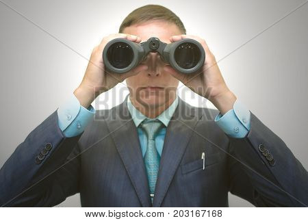 Search of investment. Market research. Searching job. Mentor interns. Businessman in suit with binoculars in hand. Manager in search of new customer. Work descipline control. Supervisor. Surveillance.