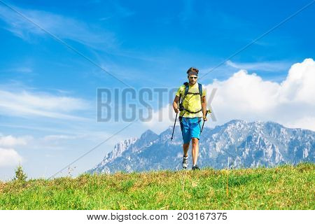 Young Man Practicing Physical Activity Mountain And Running With Sticks