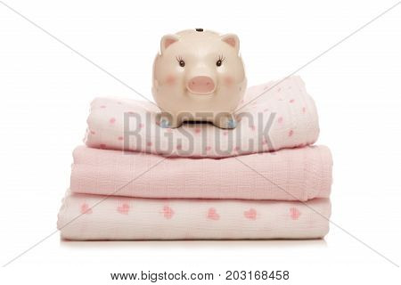 piggy bank on pink muslins on a white background cutout