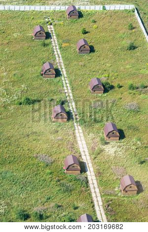 Above View Of Several Wooden Houses In Village