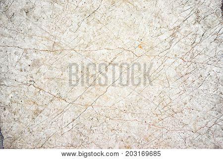 Beige neutral cracked marble stone floor texture