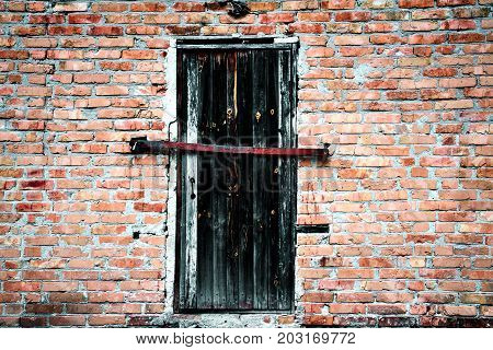 Old exterior door on brick building exterior