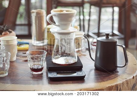 Drip Coffee Glass Kits, coffee pot,filter, jar and scale in a Coffee shop cafe.