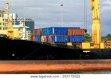 Labuan,Malaysia-Aug 30,2017:A large cargo container ship with container in the port of Labuan island,Malaysia.The abolishment of cabotage policy is set to benefit this duty-free-island economically