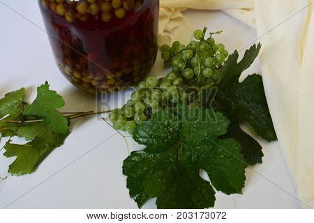 grape juice enclosed in jars and the berries green grapes