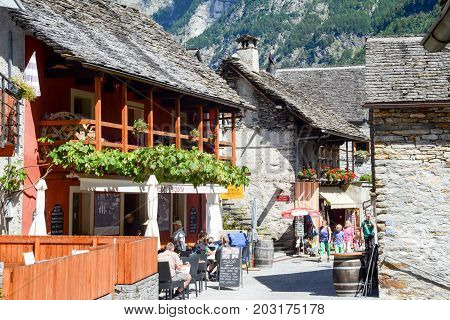 Sonogno Switzerland: 1 September 2014: Tourists visiting the rural village of Sonogno on Verzasca valley on the italian part of Switzerland