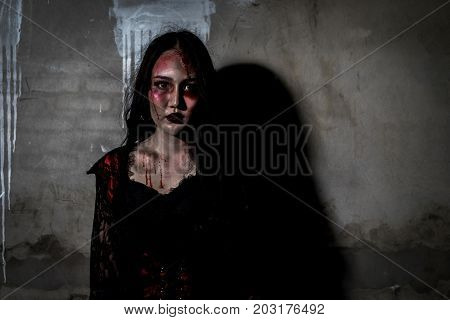 Zombie women death or witch the ghost with blood skin is screaming darkness and nightmare background horror of scary fear on hell is monster devil girl in halloween festival concept