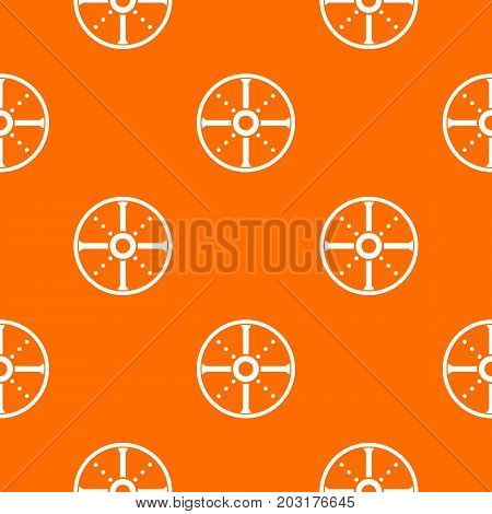 Round shield pattern repeat seamless in orange color for any design. Vector geometric illustration