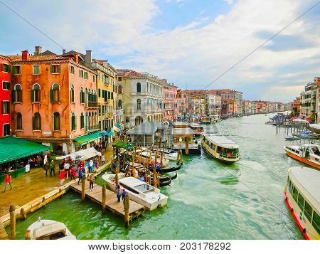 Venice, Italy - May 04, 2017: The people at water transport at Grand Canal. View from Rialto bridge at Venice, Italy at rainy day on May 04, 2017