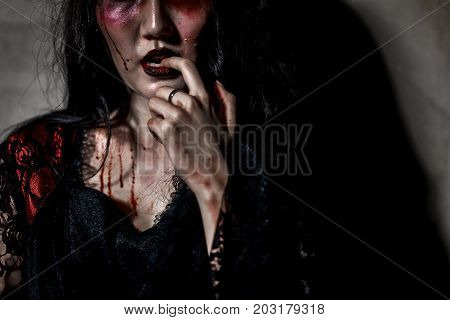 Zombie women death or witch the ghost drain hand blood skin is screaming darkness and nightmare horror of scary fear on hell is monster in halloween festival conceptcopy space the right.
