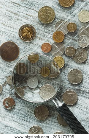 Different Old Coins And Magnifying Glass, Soft Focus Background