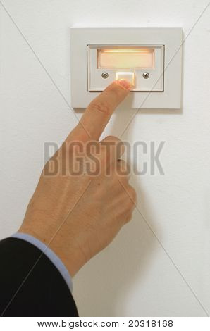 hand (suit)pressing doorbell.Add your own text inside the bell if you wish