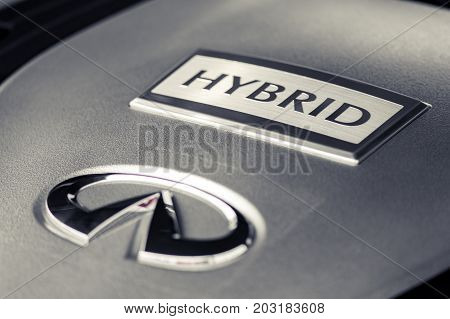 Wroclaw, Poland -  August 19Th, 2017: Hybrid Sign On Front Of Infinity Engine. Infiniti Is The Luxur