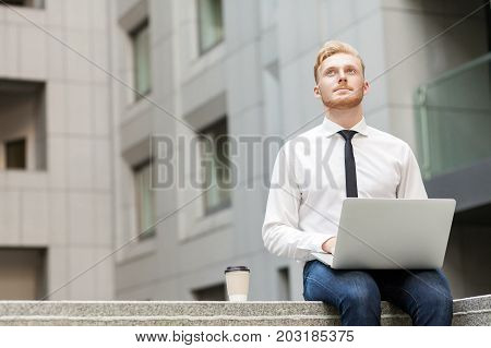 Young Adult Businessman Working Outsourcing And Wondering .