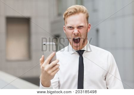 Crazy Roar And Looking At Camera. Red Head Businessman.