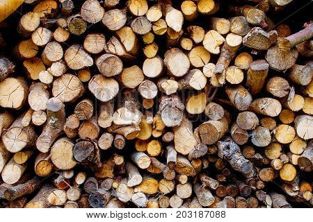Pile of wood for heating. Brown color