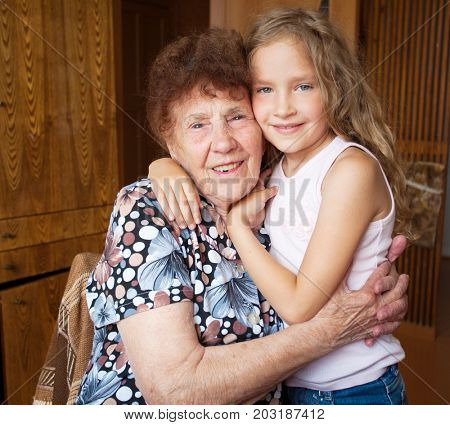 Generation. Elderly woman with great-grandchild. Senior with child.