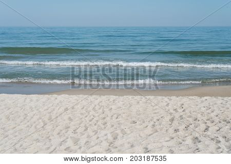Summer landscape on a sunny day. Sea and sandy beach