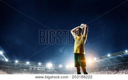 Soccer player at field. Mixed media