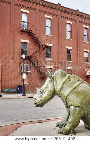 Sheridan, Usa - October 30, 2016: Bronze Rhino On A Pavement. This Sculpture Called The Boss Was Cre