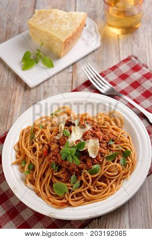Spaghetti alla bolognese with basil and Parmesan cheese