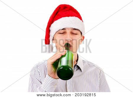 Young Man in Santa Hat with a Beer on the White Background