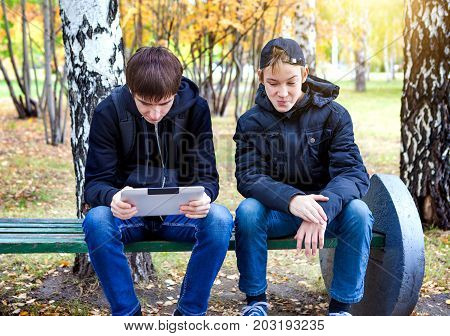 Boys with Tablet Computer in the Autumn Park