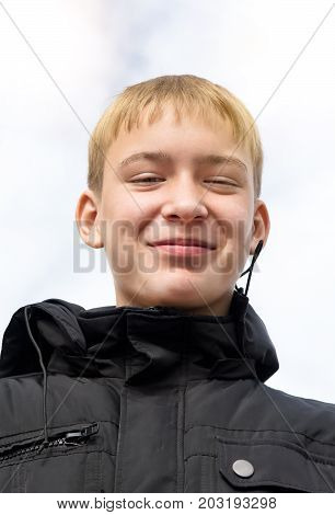 Happy Teenager Portrait on the Sky Background