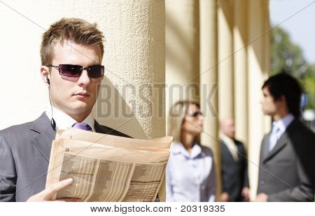 businessman reading financial paper