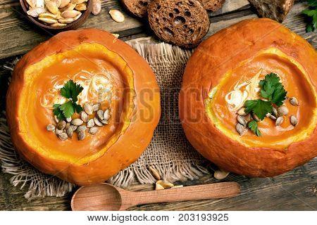 Pumpkin cream soup top view. Healthy diet food
