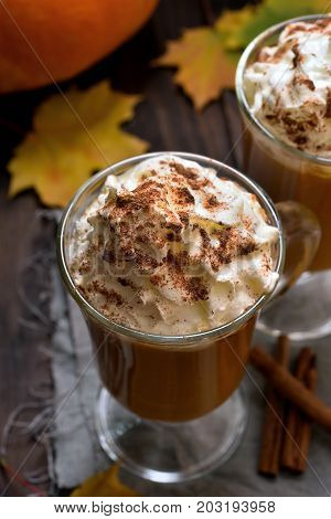 Healthy drink. Pumpkin latte with whipped cream and cinnamon