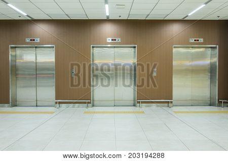 Metal office building elevator closed three doors