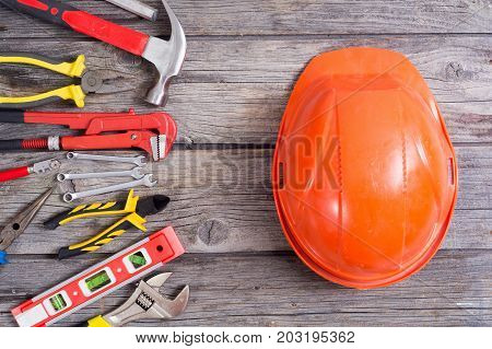 Set of tools on wooden background . Top view