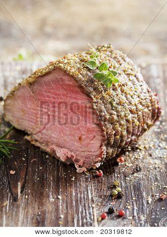 juicy roast beef covered in herbs