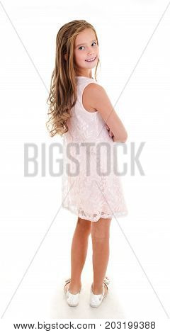Adorable smiling little girl child back in princess dress isolated on a white
