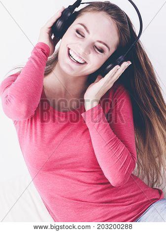 Charming woman listen to music. Female listen music.