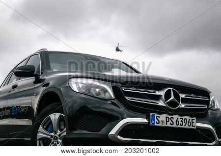 Minsk Belarus - August 26 2017: Front view of Mercedes-Benz GLC 350 e Plug-In Hybrid against the helicopter in the sky.