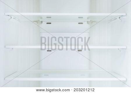 Empty shelves in refrigerator, Shortage concept .