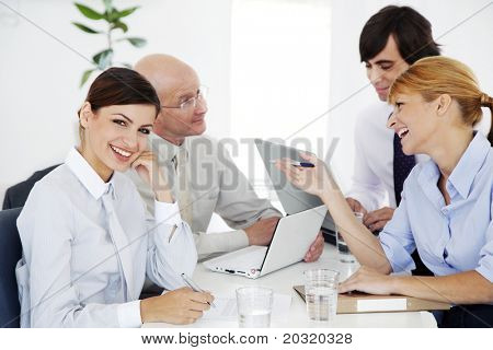 business meeting, ambitious young woman looking at camera