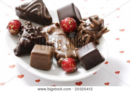 assortment of chocolate covered gingerbread with almonds and nuts