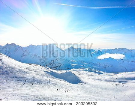 Les Deux Alpes ski resort slopes, mountain panorama and sun aerial view, France, French Alps