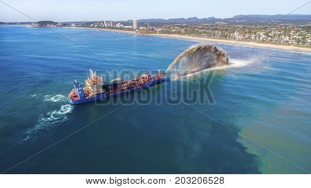 GOLD COAST, AUSTRALIA - SEPTEMBER 10 2017: Aerial view of the Balder R dredger pumping sand towards Surfers Paradise coastline to replenish the beaches.