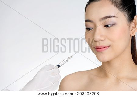 Doctor Hand Use  Syringe Injection  To Woman Face  Concept Healthcare For Beauty She Need Or Not