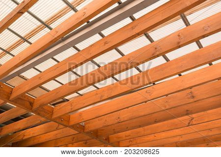 Wooden beams with fiber roof. Interior design