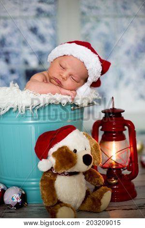 Portrait Of A Newborn Baby Boy,l Wearing Christmas Hat, Sleeping