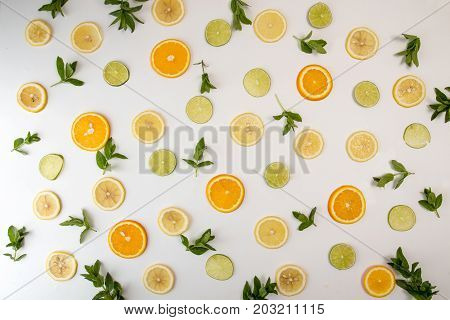 Flat Lay Still Life With Mint And Citrus: Orange Fruit; Lime; Lemon, Lime On White Background. Pop A