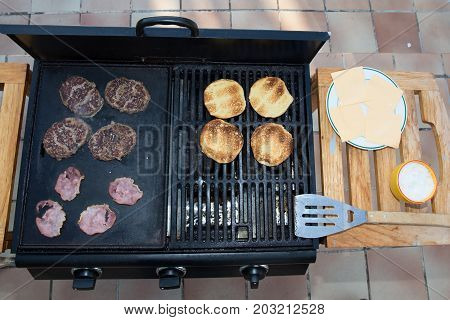 Cooking Delicious Juicy Meat Burgers And Buns On The Grill Outdoor